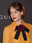 LOS ANGELES, CA - NOVEMBER 07: Actress Dakota Johnson, wearing Gucci attends LACMA 2015 Art+Film Gala Honoring James Turrell and Alejandro G Iñárritu, Presented by Gucci at LACMA on November 7, 2015 in Los Angeles, California.