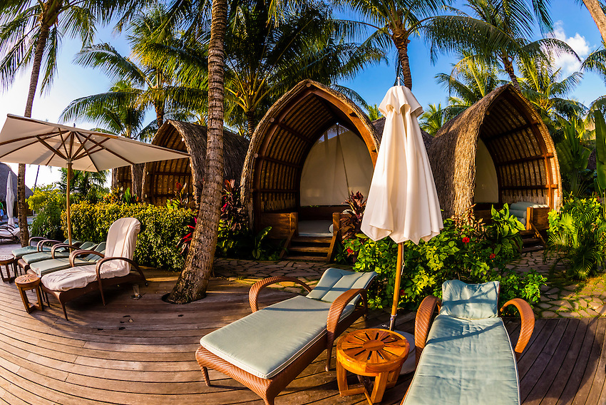 Cabanas by the swimming pool, Four Seasons Resort Bora Bora, French Polynesia.