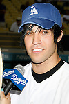 LOS ANGELES, CA. - September 02: Pete Wentz   posing before he throws the ceremonial first pitch at Dodger Stadium in Los Angeles, California on September 2, 2009.