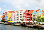Colorful buildings and outdoor cafe on the waterfront, Willemstad, Curacao