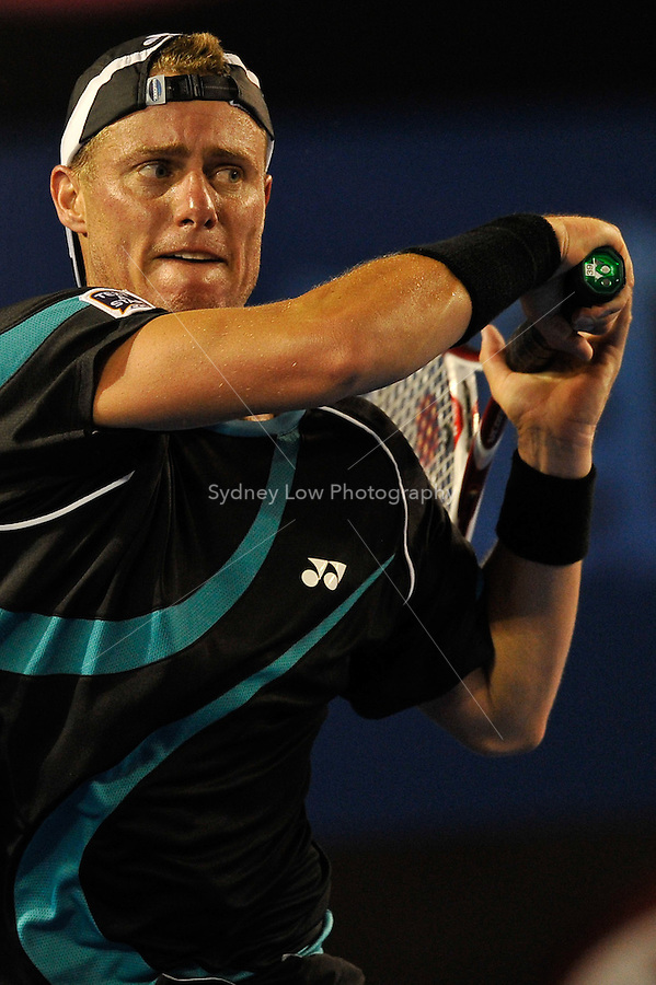 MELBOURNE, 18 JANUARY - Lleyton Hewitt (AUS) in action during his first round match against David Nalbandian (ARG) on day two of the 2011 Australian Open at Melbourne Park, Australia. (Photo Sydney Low / syd-low.com)