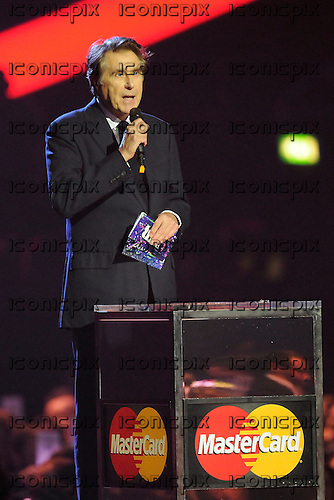 BRYAN FERRY - announces the winner of the Mastercard British Album Of The Year is Emeli Sande at the 2013 Brit Awards held at the O2 Arena in London UK - 20 Feb 2013.  Photo credit: George Chin/IconicPix