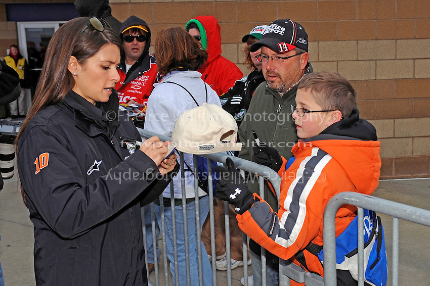 Danica Patrick (#10) signs autographs.