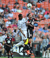 Chris Pontius (13) of D.C. United goes against Carlyle Mitchell (24) of the Vancouver Whitecaps FC. The Vancouver Whitecaps FC defeated D.C. United 1-0, at RFK Stadium, Saturday June 29 , 2013.