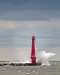 Muskegon, Michigan<br /> Muskegon Breakwater Light pounded by waves under stormy skies, Lake Michingan