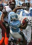 09 September 2006: North Carolina's Ronnie McGill (25) is tackled by Virginia Tech's Noland Burchette (96). The University of North Carolina Tarheels lost 35-10 to the Virginia Tech Hokies at Kenan Stadium in Chapel Hill, North Carolina in an Atlantic Coast Conference NCAA Division I College Football game.