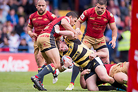 Picture by Allan McKenzie/SWpix.com - 22/04/2018 - Rugby League - Ladbrokes Challenge Cup - York City Knight v Catalans Dragons - Bootham Crescent, York, England - Connor Robinson is tackled by Catalans David Mead.