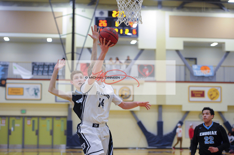Eagle River's Aaron Davis beats Chugiak's Terrance Coates to the hoop for a layup at Eagle River High School Tuesday January 19, 2016.  Photo for the Star by Michael Dinneen.