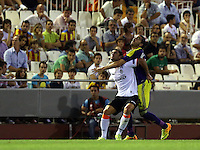 Valencia, Spain. Thursday 19 September 2013<br /> Pictured L-R: Helder Postiga of Valencia challenged by Chico Flores of Swansea. <br /> Re: UEFA Europa League game against Valencia C.F v Swansea City FC, at the Estadio Mestalla, Spain,