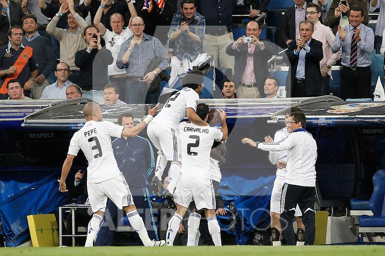 Real Madrid's Emanuel Adebayor scores during Champions League match on April, 5th 2011...Photo: Cesar Cebolla / ALFAQUI