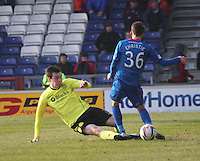 Sean Kelly tackles Ryan Christie in the Inverness Caledonian Thistle v St Mirren Scottish Professional Football League Premiership match played at the Tulloch Caledonian Stadium, Inverness on 29.3.14.
