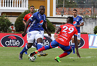 IPIALES - COLOMBIA, 23-03-2019: José Ortiz de Deportivo Pasto disputa el balón con Eliser Quiñones de Millonarios, durante partido entre Deportivo Pasto y Millonarios, de la fecha 11 por la Liga Águila I 2019, jugado en el estadio Municipal de Ipiales de la ciudad de Ipiales. / Jose Ortiz of Deportivo Pasto fights for the ball with Eliser Quiñones of Millonarios, during a match between Deportivo Pasto and Millonarios, of the 11th date for the Aguila Leguaje I 2019 at the Municipal de Ipiales stadium in Ipiales city. Photo: VizzorImage. / Leonardo Castro / Cont.