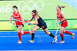 Lidewij Welten #12 of Netherlands chases the ball while Helen Richardson-Walsh #8 of Great Britain covers during Netherlands vs Great Britain in the gold medal final at the Rio 2016 Olympics at the Olympic Hockey Centre in Rio de Janeiro, Brazil.