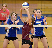 NWA Democrat-Gazette/BEN GOFF @NWABENGOFF<br /> Hannah Martin (left) and Samantha Lassiter of Rogers time their block as Chloe Price of Siloam Springs sets the ball on Thursday Aug. 27, 2015 during the match at Rogers High.