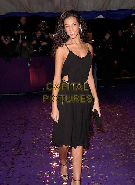 TERRI SEYMOUR.British Comedy Awards 2004  - Arrivals.London Television Studios..December 22nd, 2004.full length, black dress.www.capitalpictures.com.sales@capitalpictures.com.© Capital Pictures.