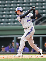 Outfielder Walker Moses (10) of the Northwestern Wildcats hits in a game against the Furman University Paladins on Saturday, February 16, 2013, at Fluor Field in Greenville, South Carolina. The game was cancelled in the fifth inning due to snow. (Tom Priddy/Four Seam Images)