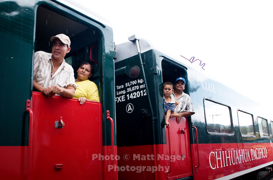 Passengers look out a window on a train north through Barranca del Cobre (Copper Canyon) using the last passenger train in Mexico passes through a tunnel, Friday, June 20, 2008. ..PHOTOS/ MATT NAGER