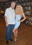 """CORAL GABLES, FL - APRIL 10: Gigi Gorgeous and Steve Moss (L) during a Q&A and book signing to Promotes Her New Book """"He Said, She Said: Lessons, Stories, and Mistakes from My Transgender Journey"""" at Books and Books on April 10, 2019 in Coral Gables, Florida. ( Photo by Johnny Louis / jlnphotography.com )"""