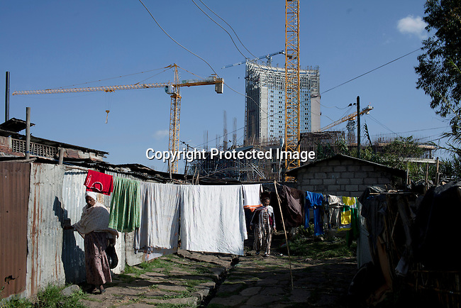 ADDIS ABABA, ETHIOPIA - NOVEMBER 17: Residents live next to the construction site of the new African Union Buildings on November 17, 2010 in Addis Ababa, Ethiopia. The building is built for free by the Chinese. Chinese companies are investing and working all over Africa and in Ethiopia they are mainly occupied with infrastructure projects around the country. (Photo by: Per-Anders Pettersson)