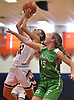 Emma LoPinto #12 of Manhasset, left, drives to the net for two points that extended the Indians' lead over Farmingdale to 40-27 in the fourth quarter of a non-league girls basketball game played at Manhasset High School on Saturday, Dec. 8, 2018. She scored 16 points Manhasset's 50-33 win.