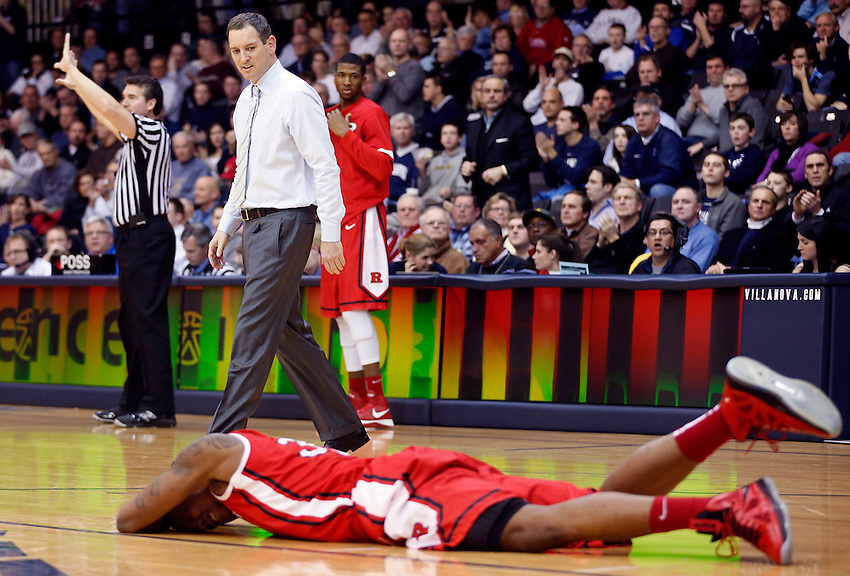 VILLANOVA, PA - (Feb. 18, 2013) - Rutgers head coach Mike Rice appears to sneer as he walks out onto the court during a timeout as one of his players, Wally Judge (33), lies injured on the court during men's Big East basketball action at Villanova University.  Rice was fired by Rutgers for abusing his players about  a month later.