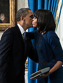 United States President Barack Obama kisses US first lady Michelle Obama after being sworn in for a second term as President in the Blue Room of the White House January 20, 2013 in Washington, DC. Obama was officially sworn in for his second term as the 44th President of the United States during the 57th Presidential Inauguration but will also participate in a ceremonial swearing in on Monday. .Credit: Brendan Smialowski / Pool via CNP