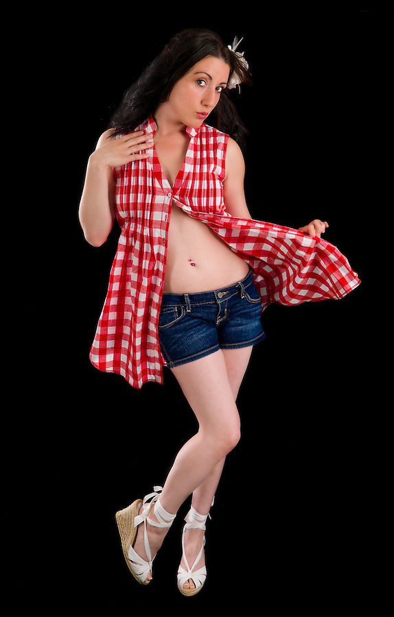 Young woman playing silly with pinup style