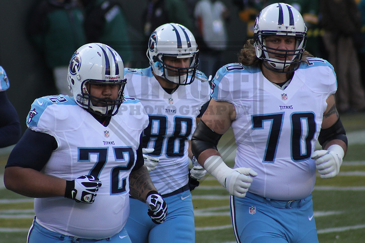 GREEN BAY - December 2012: Deuce Lutui (72), Craig Stevens (88) and Daniel Baldridge (70)  of the Tennessee Titans prior to a game against the Green Bay Packers  on December 23, 2012 at Lambeau Field in Green Bay, Wisconsin. Green Bay defeated Tennessee 55-7. (Photo by Brad Krause).