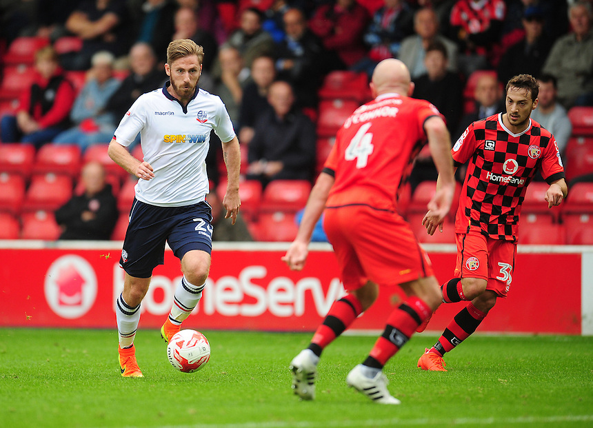 Bolton Wanderers' James Henry under pressure from Walsall's James O'Connor<br /> <br /> Photographer Kevin Barnes/CameraSport<br /> <br /> The EFL Sky Bet League One - Walsall v Bolton Wanderers - Saturday 17th September 2016 - Banks's Stadium - Walsall<br /> <br /> World Copyright &copy; 2016 CameraSport. All rights reserved. 43 Linden Ave. Countesthorpe. Leicester. England. LE8 5PG - Tel: +44 (0) 116 277 4147 - admin@camerasport.com - www.camerasport.com