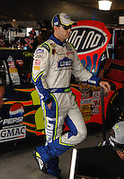 Mar 31, 2007; Martinsville, VA, USA; Nascar Nextel Cup Series driver Jimmie Johnson (48) stands next to the car of teammate Jeff Gordon (24) during practice for the Goody's Cool Orange 500 at Martinsville Speedway. Martinsville marks the second race for the new car of tomorrow. Mandatory Credit: Mark J. Rebilas..