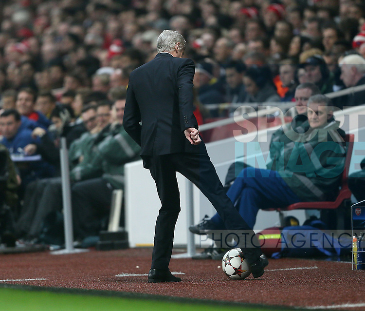 Arsenal's Arsene Wenger tries to control the ball<br /> <br /> UEFA Champions League- Arsenal vs Borussia Dortmund- Emirates Stadium - England - 26th November 2014 - Picture David Klein/Sportimage