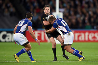 Beauden Barrett of New Zealand is tackled by Johan Deysel of Namibia. Rugby World Cup Pool C match between New Zealand and Namibia on September 24, 2015 at The Stadium, Queen Elizabeth Olympic Park in London, England. Photo by: Patrick Khachfe / Onside Images