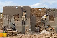BURKINA FASO, P&oacute; , clay house construction in village / Burkina Faso <br /> Wiederaufbau eines Lehm Haus im Dorf bei P&oacute;