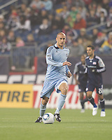 Aurelien Collin at midfield. In a Major League Soccer (MLS) match, the New England Revolution defeated Sporting Kansas City, 3-2, at Gillette Stadium on April 23, 2011.