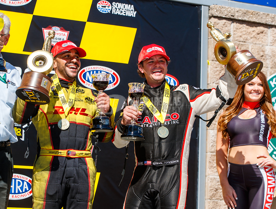 Jul 30, 2017; Sonoma, CA, USA; NHRA funny car driver J.R. Todd (left) celebrates with top fuel driver Steve Torrence after winning the Sonoma Nationals at Sonoma Raceway. Mandatory Credit: Mark J. Rebilas-USA TODAY Sports