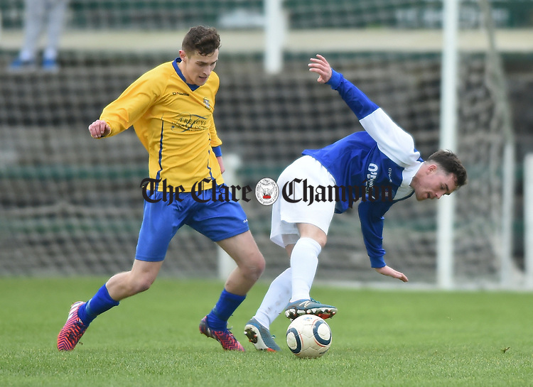 Eoin Whelan of Clare in action against John Connery of Limerick during their FAI Oscar Traynor game in Limerick. Photograph by John Kelly.