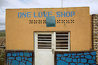 "Rwanda. Southern province. Gitarama. District of Muhanga.  The "" One Love Shop"" is closed. Kinyarwanda language written on the wall.  © 2007 Didier Ruef"
