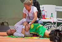 France, Paris, 28.05.2014. Tennis, French Open, Roland Garros, Anastasia Pavlyuchenkova (RUS) is being treated by a fysio for a back injury<br /> Photo:Tennisimages/Henk Koster