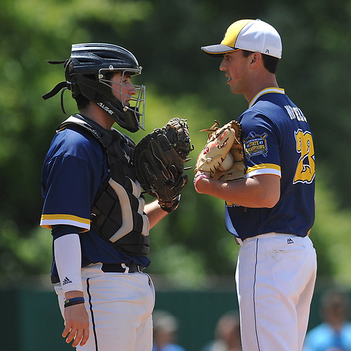 Brian Morrell #23, Shoreham-Wading River pitcher, right, chats with catcher Thomas Brady #14 during the Class A varsity baseball Long Island Championship against Wantagh at SUNY Old Westbury on Saturday, June 3, 2017.