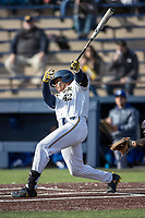 Michigan Wolverines designated hitter Jordan Nwogu (42) follows through on his swing against the San Jose State Spartans on March 27, 2019 in Game 1 of the NCAA baseball doubleheader at Ray Fisher Stadium in Ann Arbor, Michigan. Michigan defeated San Jose State 1-0. (Andrew Woolley/Four Seam Images)