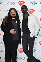 Romeo Stodart and David McAlmont<br /> at The Ivor Novello Awards 2017, Grosvenor House Hotel, London. <br /> <br /> <br /> ©Ash Knotek  D3267  18/05/2017