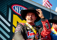 Oct 20, 2019; Ennis, TX, USA; NHRA pro stock driver Greg Anderson wears a cowboy hat after winning the Fall Nationals at the Texas Motorplex. Mandatory Credit: Mark J. Rebilas-USA TODAY Sports