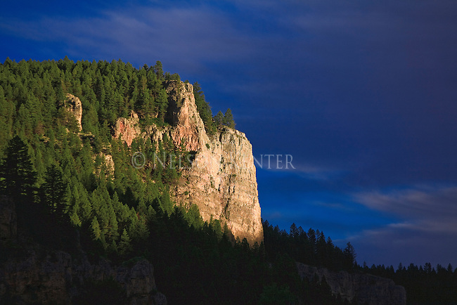 A rocky cliff along the Smith River in Montana