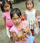 A group of young girls sell crafts in Luang Prabang in Laos.