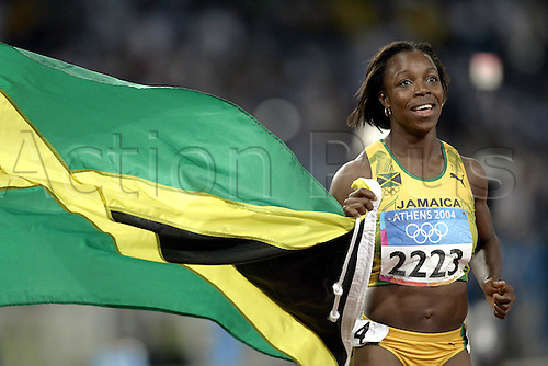 25 August 2004: Jamaican sprinter VERONICA CAMPBELL (JAM) with the Jamaican flag, celebrating her win in the Women's 200m Final at The 2004 Olympic Games, Athens, Greece. Campbell won in a time of 22.05 seconds Photo: Glyn Kirk/Action Plus...040825 athletics athlete winner winners joy celebrate celebrates celebrations celebration flags