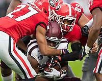 ATHENS, GA - NOVEMBER 23: Tyson Campbell #3 and Eric Stokes #27 of the Georgia Bulldogs tackle Ainias Smith #17 of the Texas A