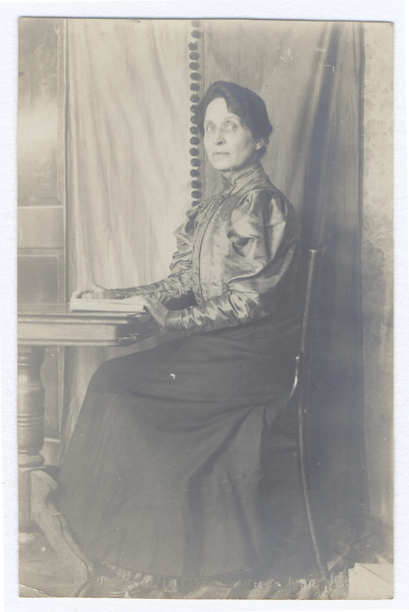 10a.<br /> <br /> (1) 3 5/16 x 2 1/8 [b=w]<br /> (2) 3 5/16 x 2 3/16 [b&ne;w]<br /> <br /> Sarah Crone. seated, at small stand, in profile, with three-quarter turn of head.<br /> This is probably at Klenzestrasse.