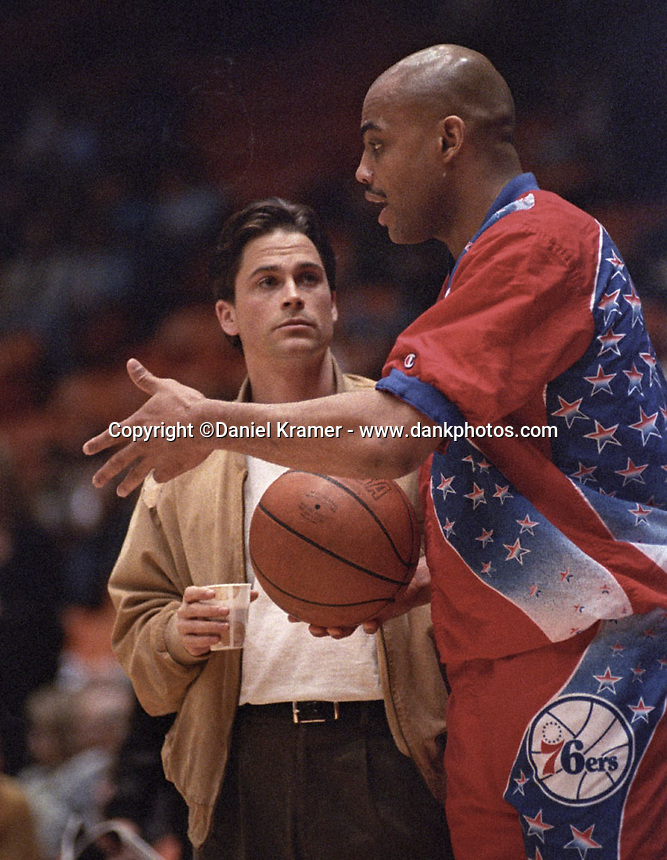 Rob Lowe and Charles Barkley share a courtside, pregame moment at the Great Western Forum in Los Angeles in the early 1990s.
