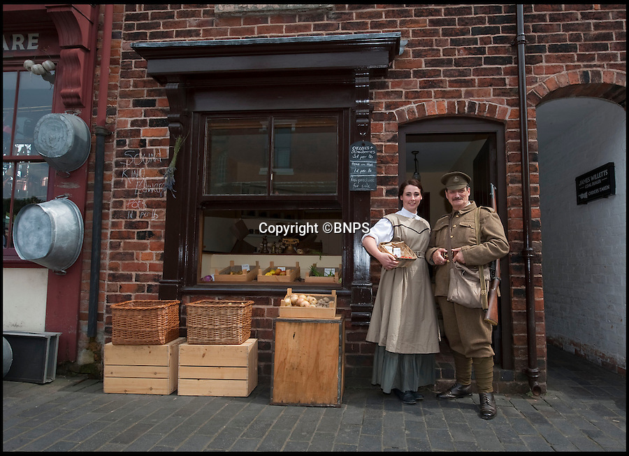 BNPS.co.uk (01202 558833)<br /> Pic: PhilYeomans/BNPS<br /> <br /> Re-Open All Hours...<br /> <br /> The re-built edwardian greengrocers shop with actors in period costume.<br /> <br /> A greengrocers shop in a Victorian two up two down has been reunited with the family that once owned it after it was painstakingly rebuilt at the Black Country Living Museum in Dudley.<br /> <br /> The turn-of-the-century greengrocers shop has re-opened for business almost a 100 years after it served its first customers - and it is an exact replica of how it used to be.<br /> <br /> Plucky housewife Gertrude Adey transformed her modest front room into a fruit and veg shop in 1916 to earn a few shillings so she could survive while husband William was off fighting in the First World War.<br /> <br /> In 1995 the historic building was demolished to pave the way for a new development in the town centre but 98 years after it first opened the shop is back in business after it was lovingly rebuilt brick by brick.<br /> <br /> The humble shop will only sell produce that was available at the time and any left over fruit and veg will be turned into pickles, chutneys and jams, just like it would have been back in the early 20th century.<br /> <br /> And staff will even be dressed in plain period clothing just as William and Gertrude would have worn. <br /> <br /> The opening of the time-warp shop is the culmination of a project by local historians who rebuilt the shop in the grounds of the Black Country Living open air museum.<br /> <br /> Three generations of the Adey family - William's grandson Jim, 85, great grandson Andrew, 54, and great-great granddaughter Melanie, 22 - officially opened the shop on Saturday.