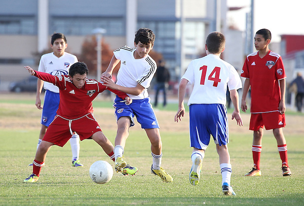 DENTON TX - NOVEMBER 30: FCD Youth 01B  vs Estudiantes FC 1B under sixteen years old soccer match on Field 6 at Toyota Soccer Center in Frisco on November 30, 2013 in Frisco, Texas. (Photo by Rick Yeatts)